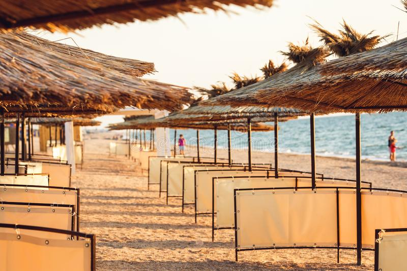 Photos of reed beach umbrellas in perspective. royalty free stock photography