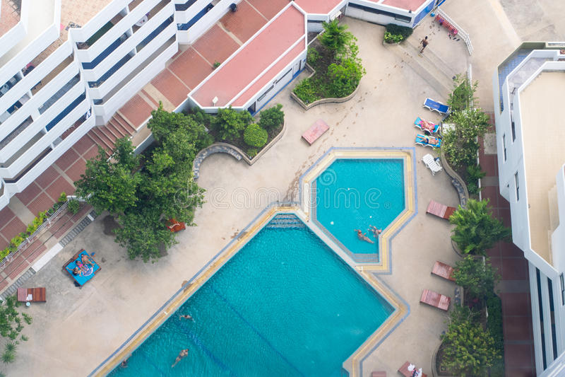 Photos from the roof of the swimming pool in the center of the courtyard house stock image