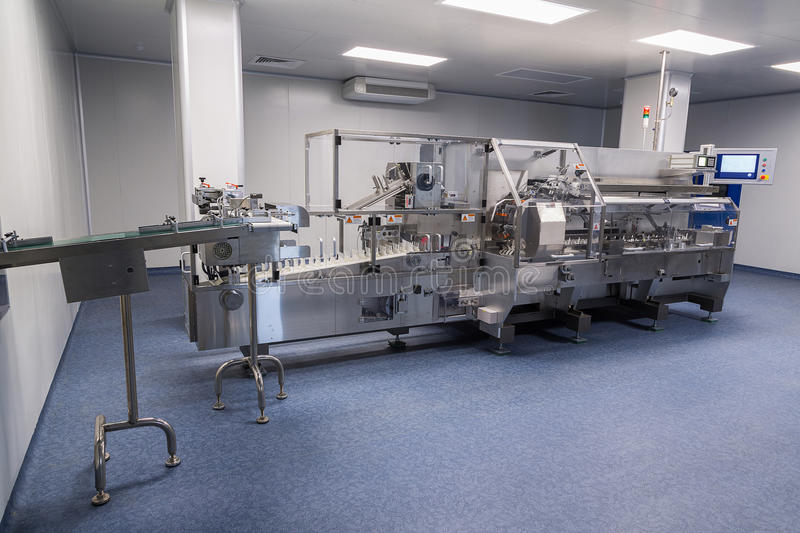 Photos sterile production area with the machine for the production of tablets and sorting stock photo