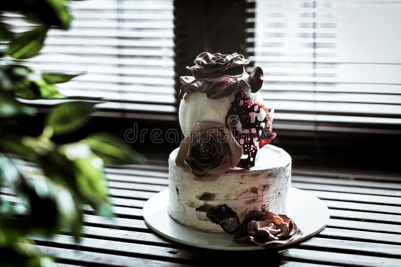 Photos of two-story cake with roses with brown isomalto. stock photography