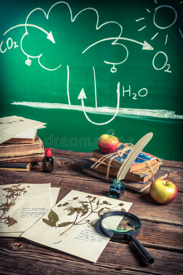 Photosynthesis lecture on biology lesson. On old wooden table stock image