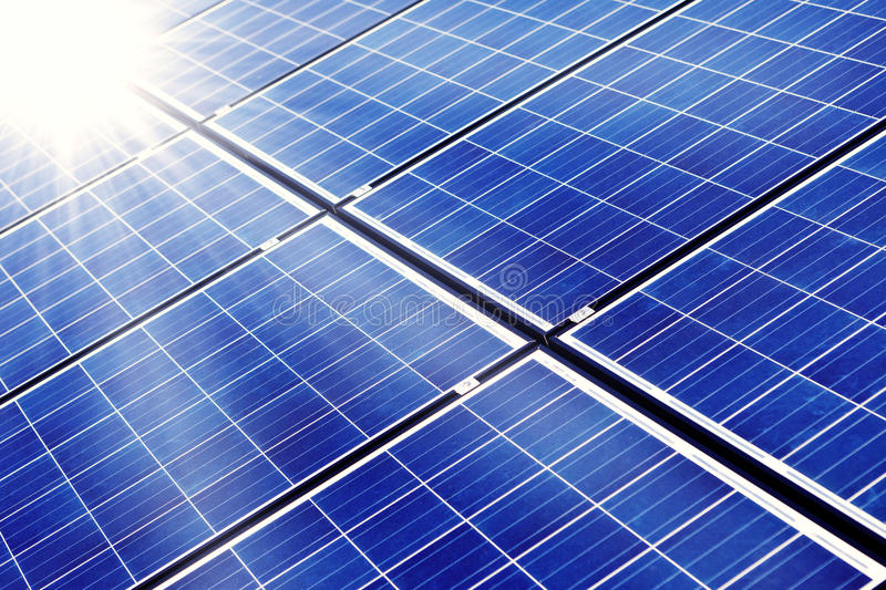 Photovoltaic. Photovaltaic cells and sunlight background royalty free stock image