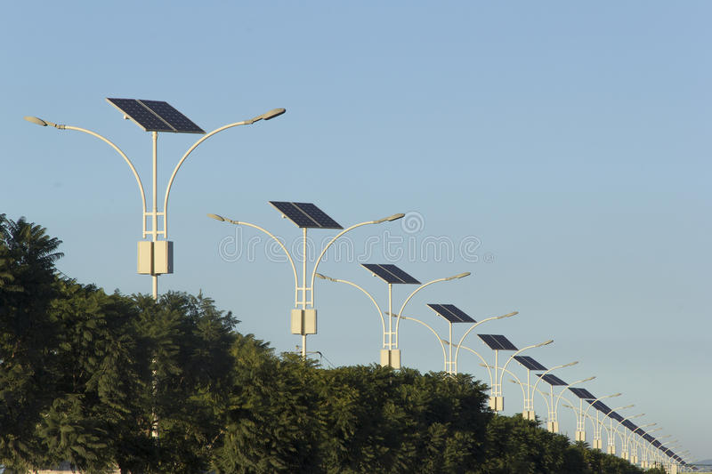 Photovoltaic cells on street lamps. Street lights with photovoltaic cells royalty free stock photos