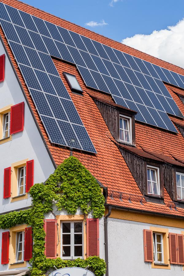 Photovoltaic. Installation on top of a roof stock image