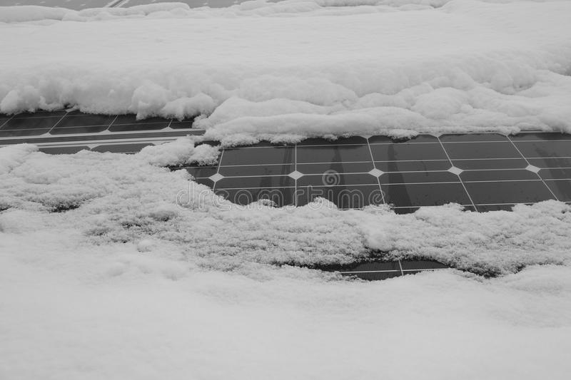 Photovoltaic modules covered with snow royalty free stock photography