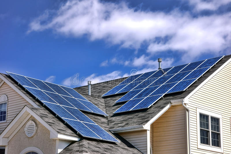 Photovoltaic Modules Solar Panels Cells on Roof stock photos