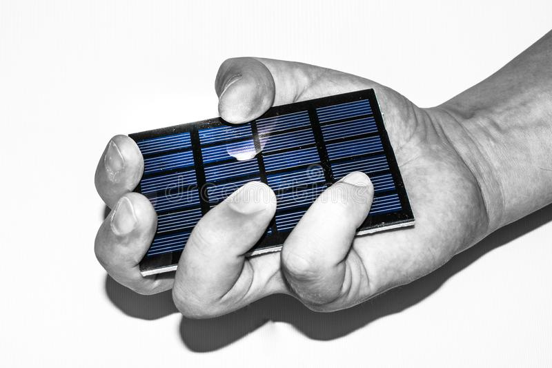 Photovoltaic panel in hand royalty free stock photos