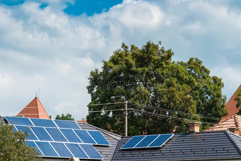 Photovoltaic panels on residentual house, blue sky storm clouds royalty free stock photography