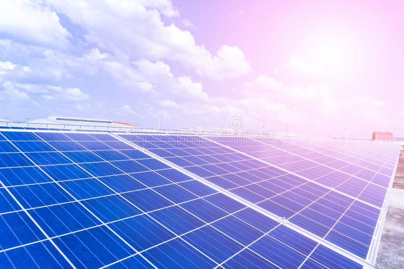 Photovoltaic panels of solar power station in the landscape with heat of sun. View from above stock photography