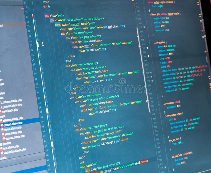 PHP code on the screen, close up. Orange, green and yellow coding on blue background stock images