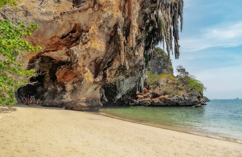 Phra Nang Cave. A cave with artificial penis on the beach in Thailand seascape rock flowing water vacation railay gold wave holiday summer motion nature caving stock photos
