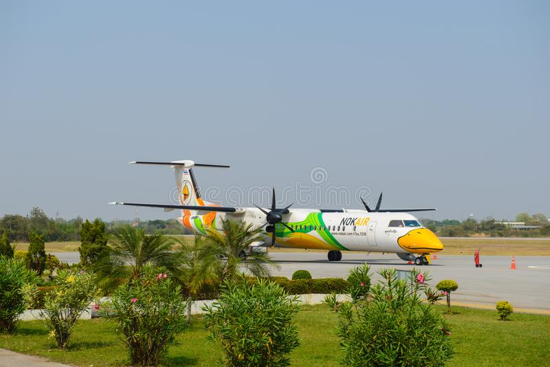 Phrae, Thailand - March 13, 2015 : The Q400 NextGen of Nok Air Reg. HS-DQD park on Phrae Airport, Thailand.  royalty free stock photos