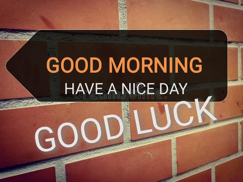 Phrase Good morning, have a nice day and good luck on brown brick wall royalty free illustration