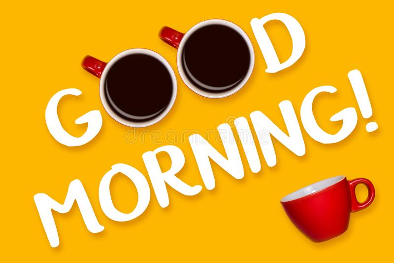 Phrase Good morning on a yellow background. Red cup on yellow. View from above.  stock image
