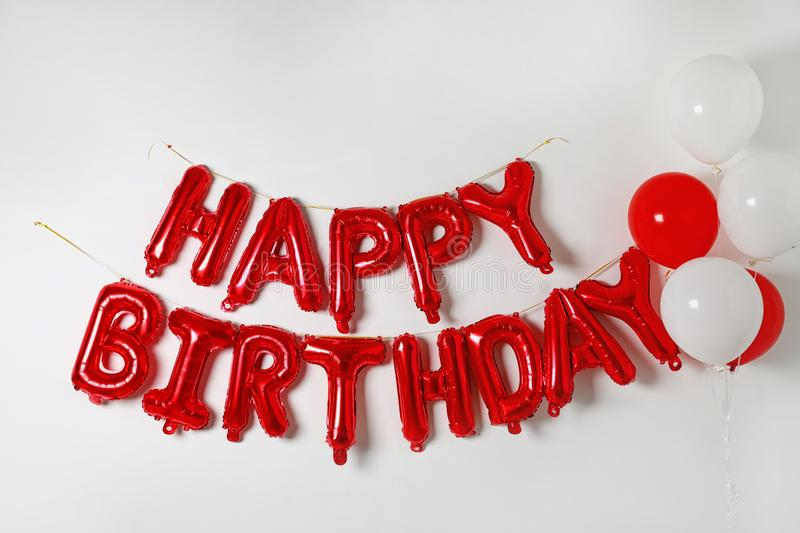 Phrase HAPPY BIRTHDAY made of color balloon letters stock photo