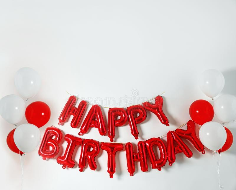 Phrase HAPPY BIRTHDAY made of color balloon letters on white background royalty free stock images