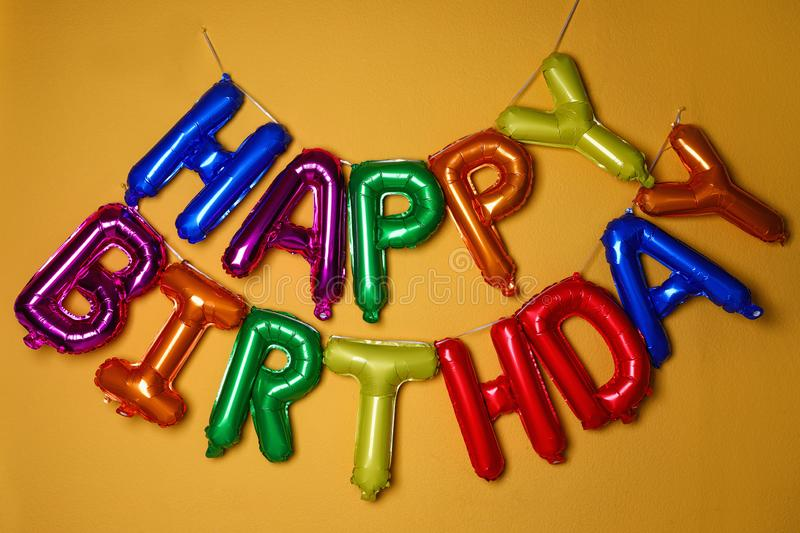 Phrase HAPPY BIRTHDAY made of colorful balloon letters stock image