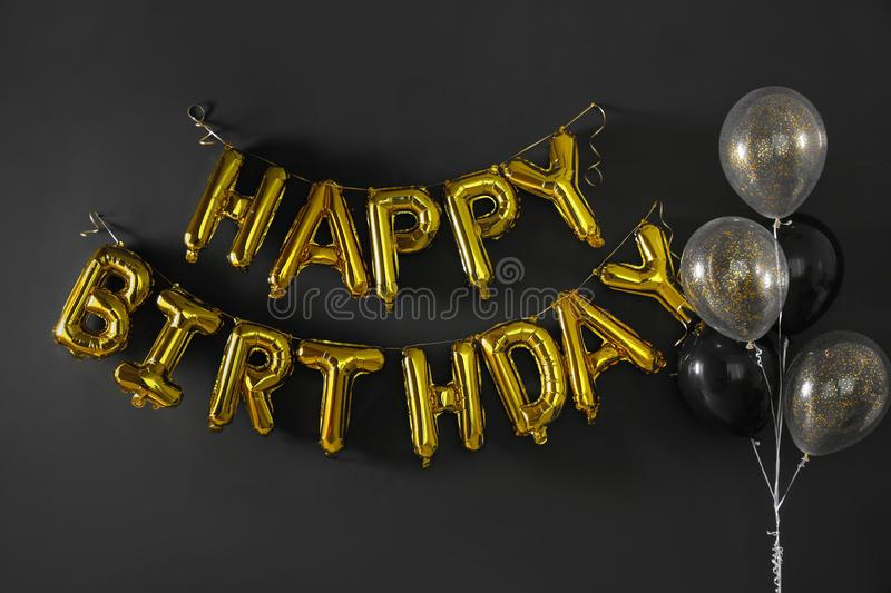 Phrase HAPPY BIRTHDAY made of golden balloon letters royalty free stock photography