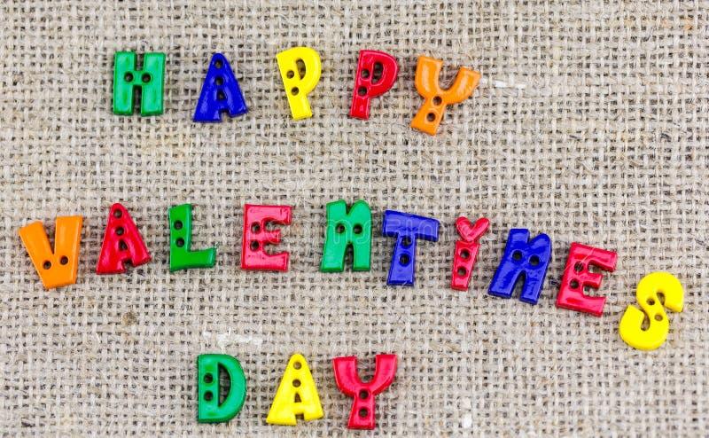 Phrase heureuse de jour de valentines écrite sur la toile photos libres de droits