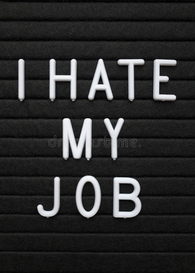 The phrase I Hate My Job in white text on a letter board. The words I Hate My Job in white plastic letters on a black letter board stock photo