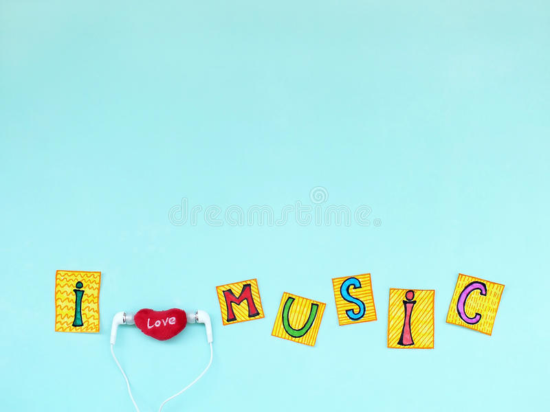 The phrase: `I love music` in cut out letters with earphones, I love music concept. I love music concept, top view stock photos