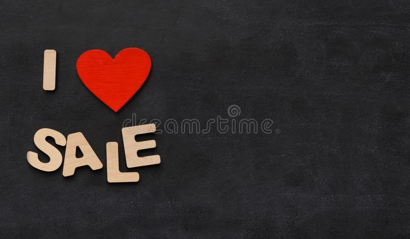 Phrase i love sales on black background with copy space stock photos