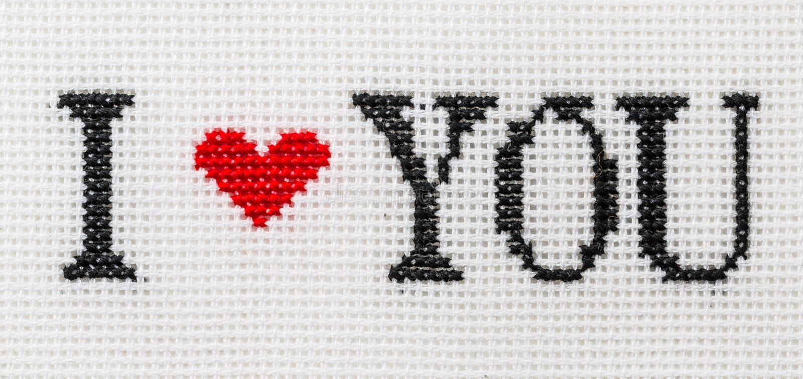 Phrase I love you embroidered red and black thread royalty free stock photo