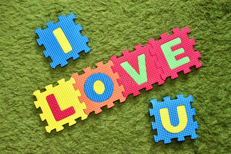 Phrase I LOVE YOU made of soft material puzzle for kids playing stock photo