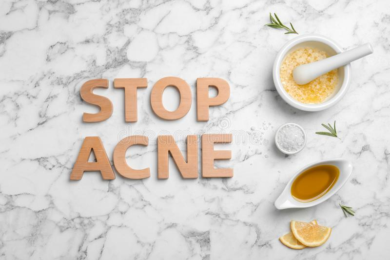 Phrase `Stop acne` and homemade problem skin remedy ingredients royalty free stock image