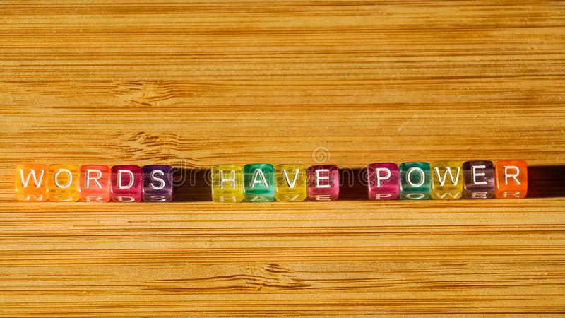 The phrase Words have power on a wooden surface of colored square blocks. stock images