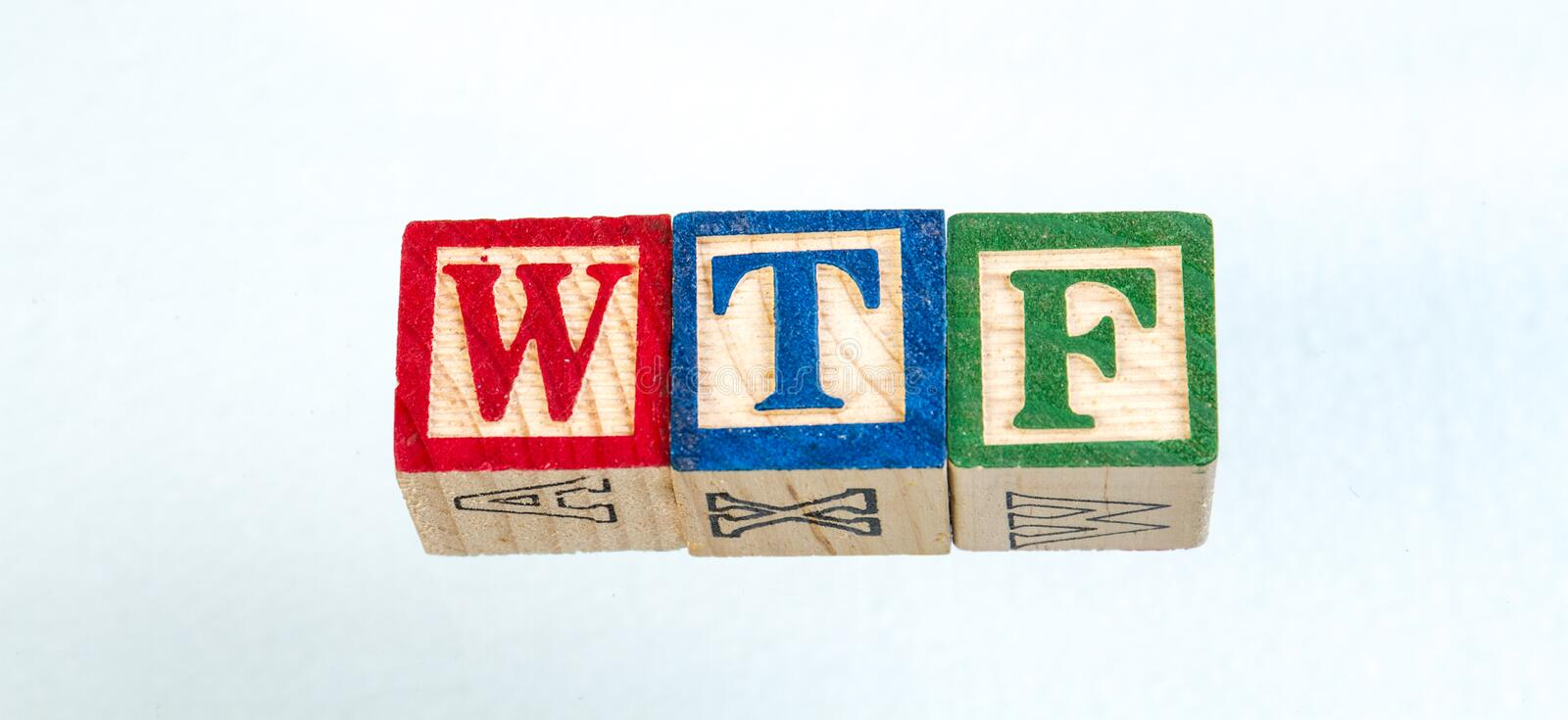The phrase WTF displayed on a white background. The term WTF visually displayed on a black background using colorful wooden toy blocks image with copy space in stock image