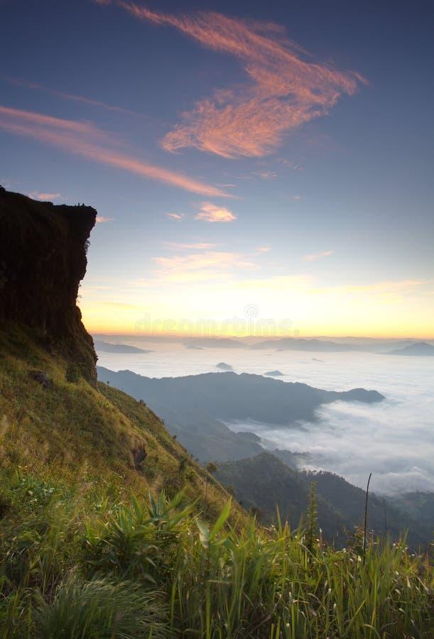 Phu chi fa in Chiangrai,Thailand. Sunrise scene with the peak of mountain and cloudscape at Phu chi fa in Chiangrai,Thailand royalty free stock photo