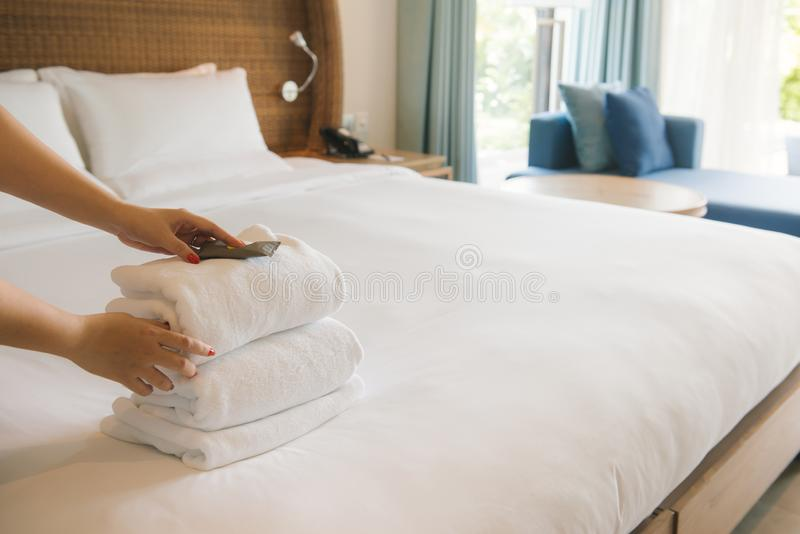 PHU QUOC, VIETNAM JUNE 28, 2017: Cropped image of a female chambermaid making bed in hotel room royalty free stock images