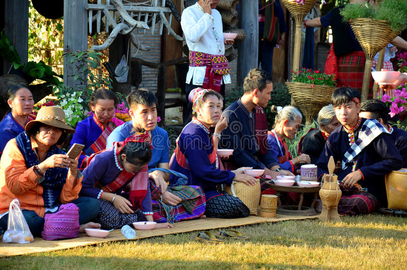 Phu Tai people sit and eat breakfast after join in phutai day fe. Stival in morning time at Ban Non Hom on January 17, 2016 in Sakon Nakhon, Thailand stock photo