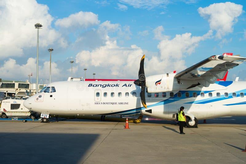 Turboprop passenger aircraft of Bangkok Airways in Phuket airport. PHUKET, THAILAND - 24 APR 17: Turboprop passenger airplane of Bangkok Airways in Phuket royalty free stock photo