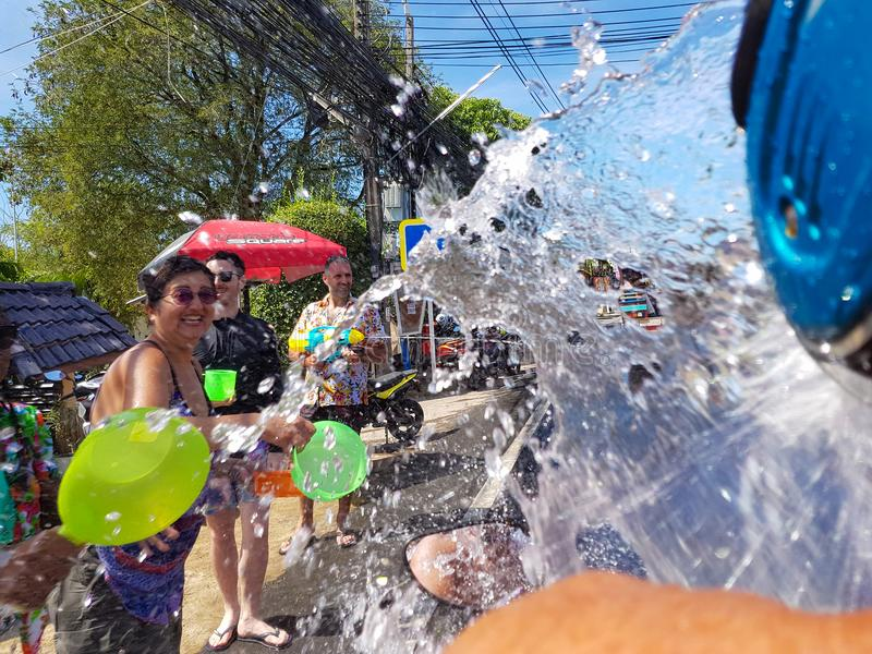 Phuket, Thailand - April 13, 2018: Crowd of people pour water on royalty free stock photos