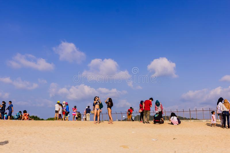 Phuket, Thailand - April 14, 2019: Tourists enjoy taking a picture with the airplane flying over them as the background, at the royalty free stock images