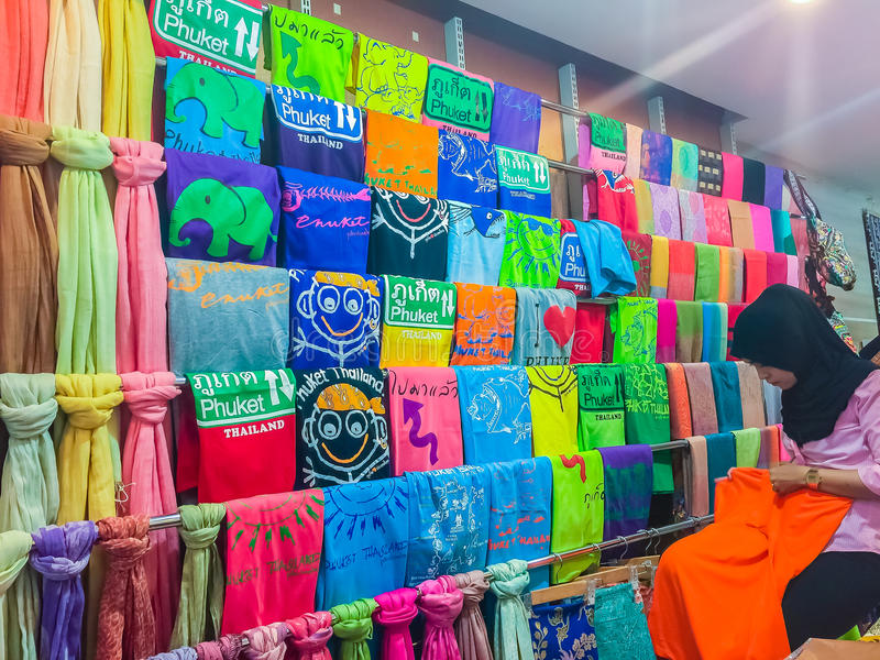 Phuket, Thailand - February 21, 2017: Phuket tourism logo printed screen on t-shirt and clothing for sale in souvenir shop royalty free stock photo