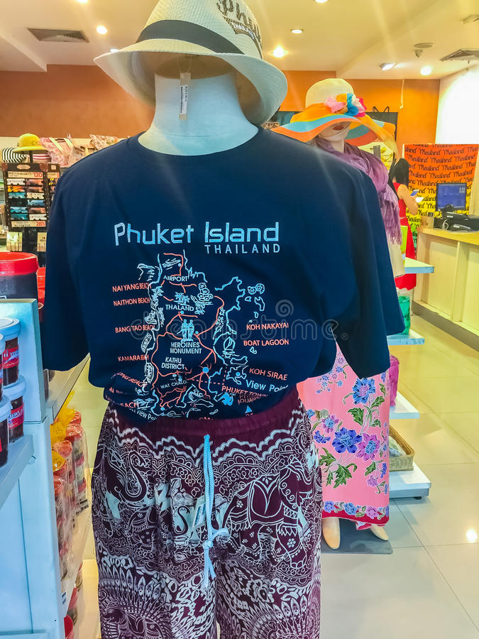 Phuket, Thailand - February 21, 2017: Phuket tourism logo printed screen on t-shirt and clothing for sale in souvenir shop royalty free stock image