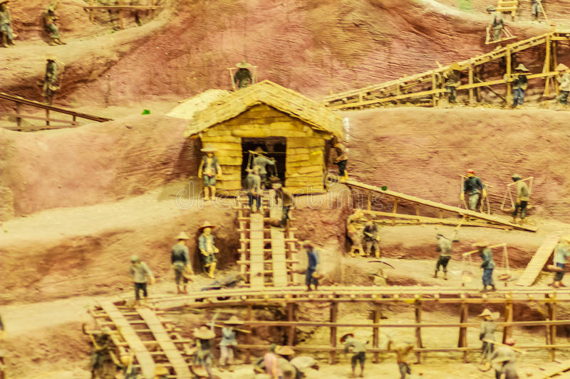 Phuket, Thailand - February 21, 2017: Tin mining dolls models sh. Own the history, miner's life, process and method of tin mining in Phuket Mining Museum, Phuket royalty free stock images