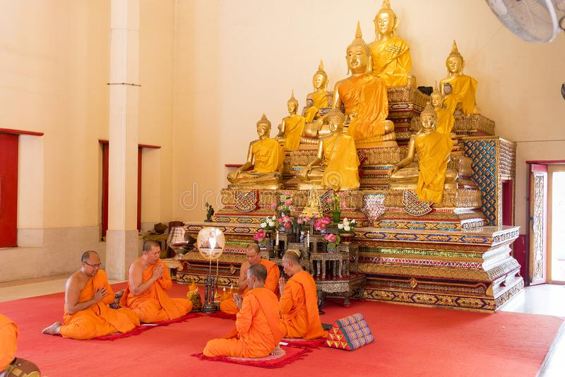 Phuket, Thailand, 04/19/2019 - Group of buddhist monks praying together at the Chalong Temple stock image