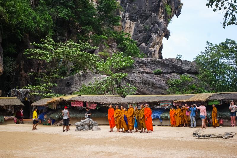 Buddhist monks at a market in a Thai village stock photos