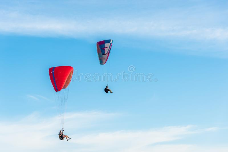 PHUKET,THAILAND-JULY 01,2019: ..Paragliding Extreme sport, Paraglider flying on the blue sky and white cloud in Summer day at Phuk stock photo