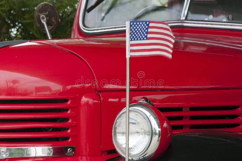 Classic American Dodge truck. Phuket, Thailand - June 4th 2912: Classic American Dodge truck and US flag. The vehicle has been restored stock photography