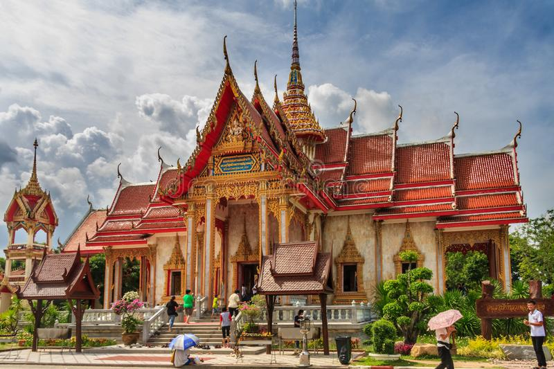 People entering the buddhist wat in Chalong. stock photos