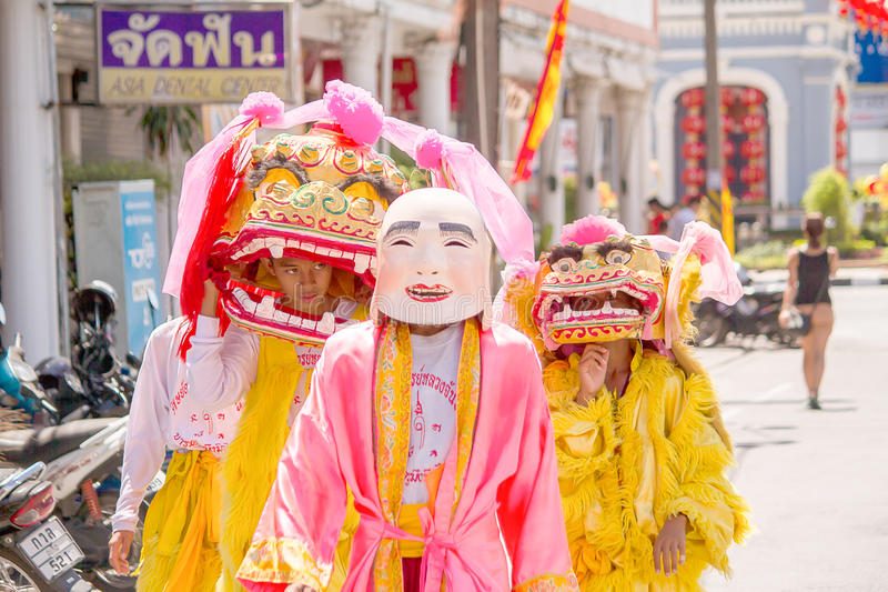Phuket, Thailand - Oct 14, 2015 : Unidentified participants wearing mascot in the ceremony during Phuket vegetarian festival stock photo