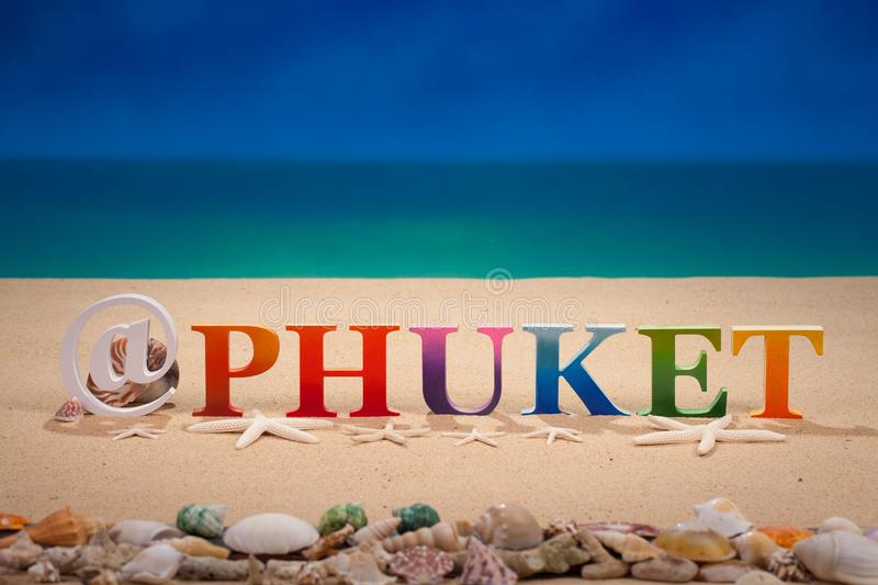 @Phuket written in colorful wood letters at the beach. @Phuket written in colorful wood letters with sea shell at the beach with copy space stock photo