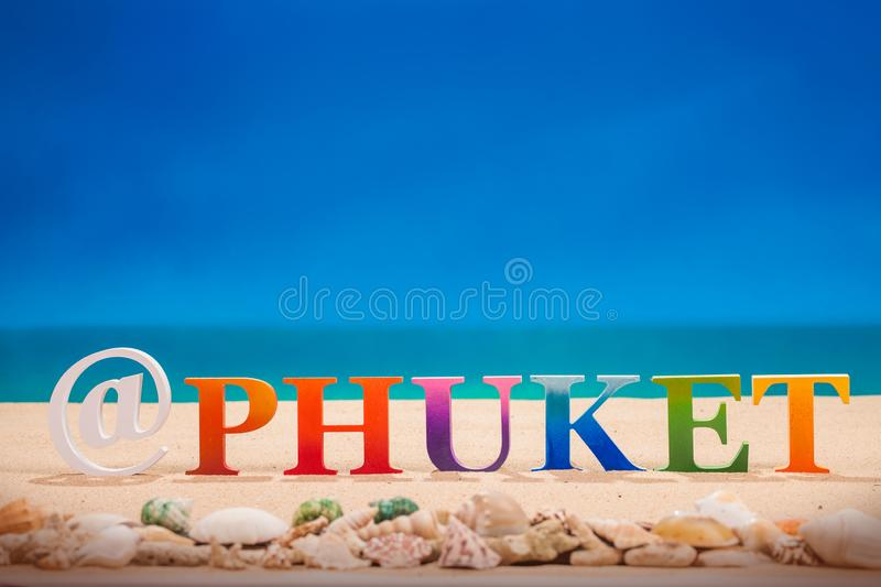 @Phuket written in colorful wood letters at the beach. @Phuket written in colorful wood letters with sea shell at the beach with copy space stock image