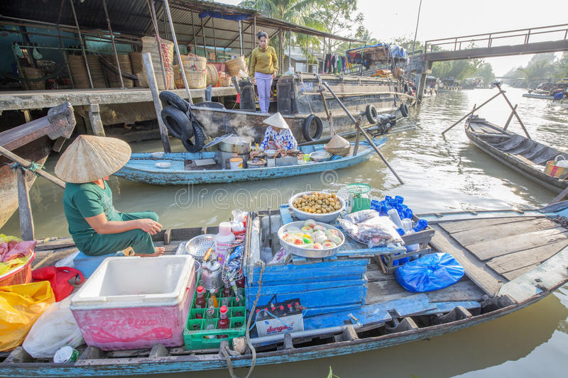 Phung Hiep floating market at seven-ways crossroads (Nga Bay), Can Tho city, Tien Giang. Local people selling food on their boat at Phung Hiep floating market, 7 stock images
