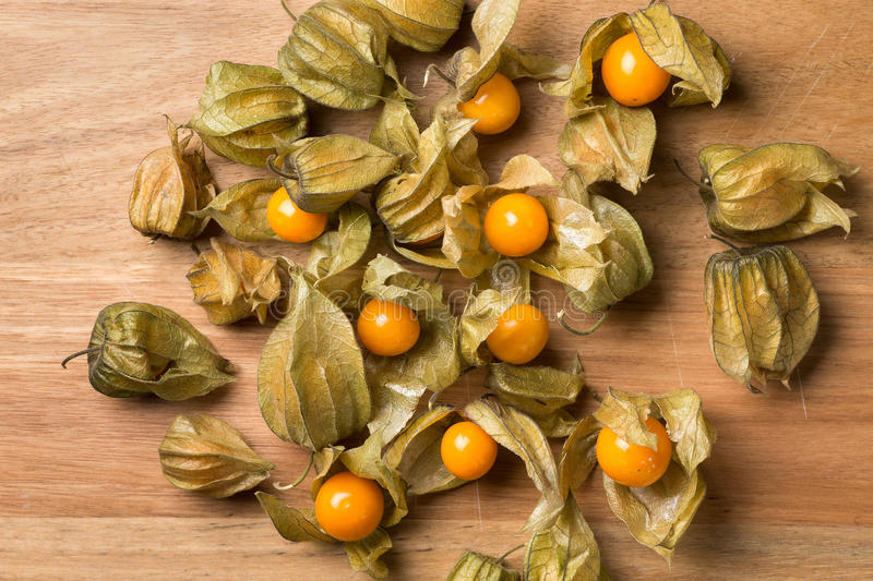 Physalis in a rectangular wooden tray stock images